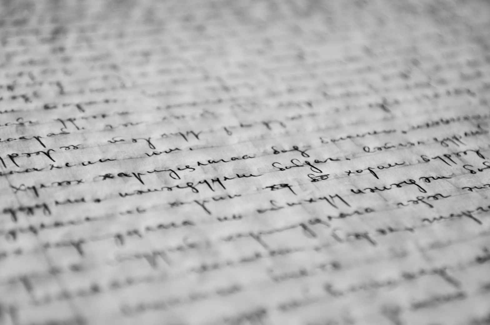 Image description: handwritten words on a page, out of focus.